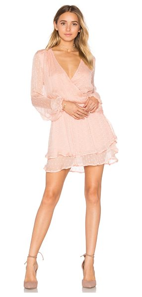 Free People Daliah Mini Dress in peach - 100% rayon. Hand wash cold. Fully lined. Surplice...