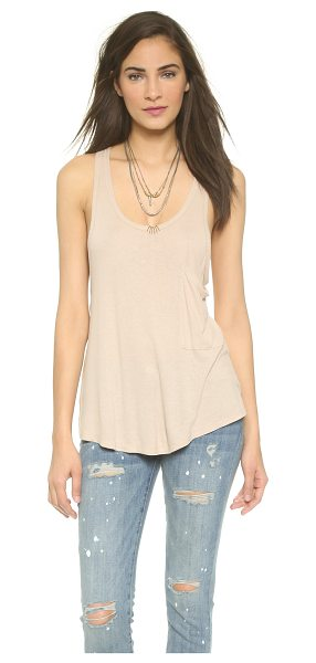 Free People Draped pocket tank in oatmeal - Slinky fabric and a flared silhouette lend effortless...