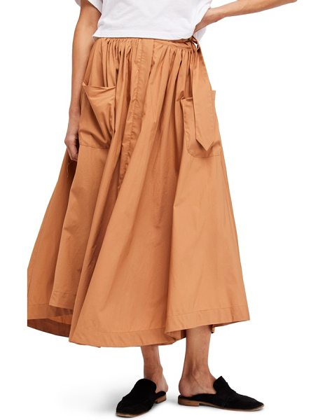 Free People dream of me midi skirt in taupe - A voluminous expanse of cotton swirls to midi length,...