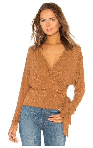 Free People East Coast Wrap Sweater in brown - Rayon blend. Rib knit fabric. Surplice bodice with tie...