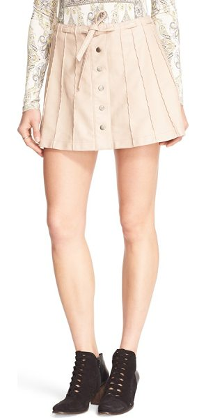 Free People faux leather miniskirt in pink - Flattering pleats add structure to a buttery-soft...