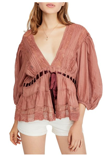 Free People favorite romance tunic in pink - Cut from semi-sheer cotton with a daringly low neckline,...