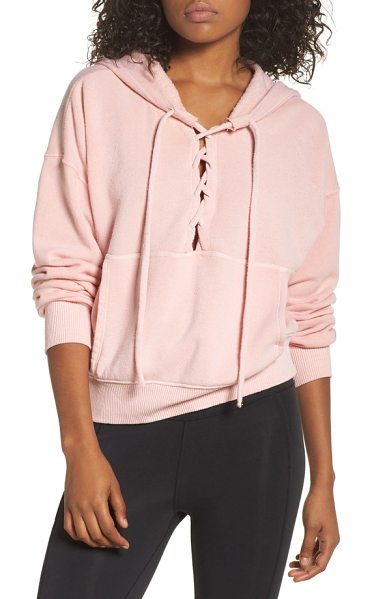 FREE PEOPLE MOVEMENT believer hoodie in pink - Soft and slouchy, this lace-up hoodie is your...