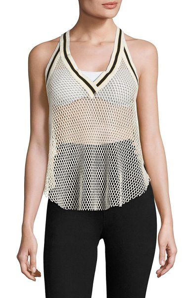 Free People get it mesh tank in cream - Contrast trim detail highlights this mesh tank.V-neck....