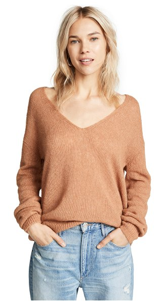 Free People gossamer v neck sweater in terracotta - Fabric: Brushed loose knit Oversized fit Ribbed knit...