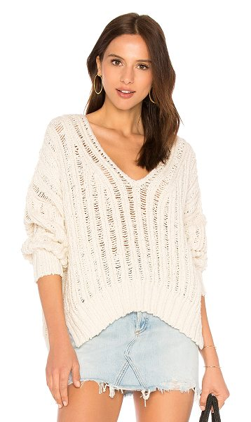 FREE PEOPLE Infinite V Neck Sweater in cream - Nylon blend. Hand wash cold. Open knit fabric. Side seam...