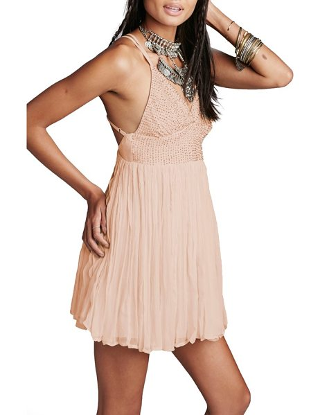 Free People like a diamond embellished minidress in peach - Tiny beads dazzle on the surplice bodice of a...