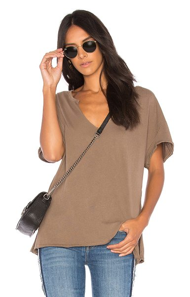 Free People Lilly Tee in taupe - 100% cotton. Raw cut edges. Slub knit fabric. Side slit....