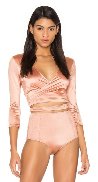 Free People Margot Wrap Top in peach - 72% polyamide 28% elastane. Wrap front with tie closure....