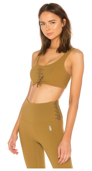 Free People Movement Before You Go Lace Up Bra in brown - Nylon blend. Front lace-up detail. Ribbed fabric....