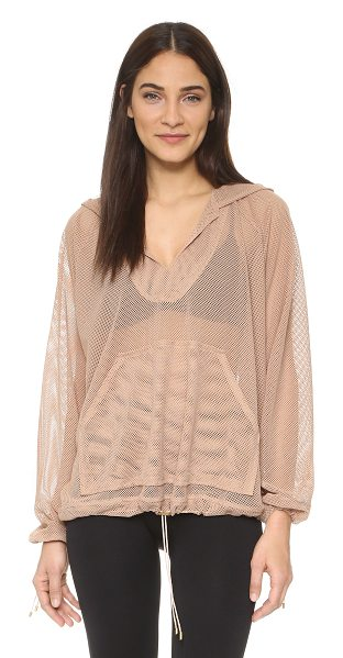 Free People Movement billowing hoodie in apricot - An oversized profile complements the airy feel of this...