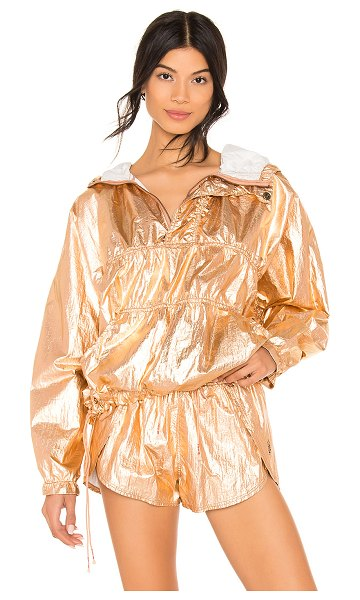 Free People Movement Wind Jammer Jacket in metallic copper - Nylon blend. Partial front zipper closure. Attached...