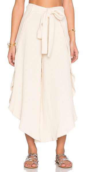 Free People Poppy Petal Pant in cream - Cotton blend. Elastic waist. Wrap around tie closure....