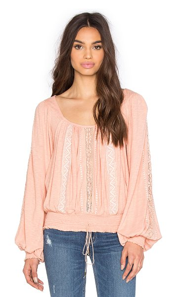 FREE PEOPLE Silverlake top in blush - 58% cotton 42% viscose. Lace-up detail. Smocked waist....