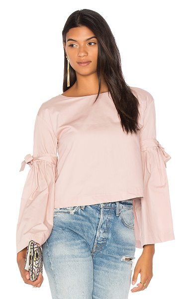 Free People So Obviously Yours Top in pink - 100% cotton. Flared sleeves with self-tie accents. Back...