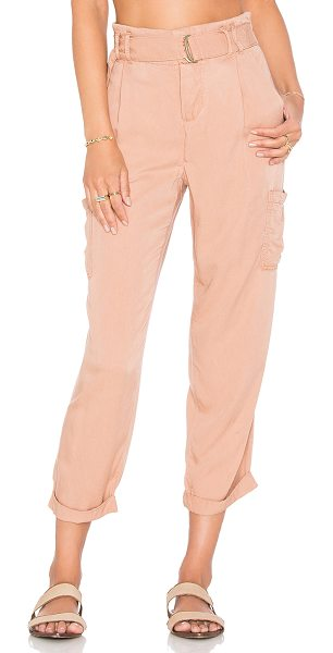 Free People Soft cargo pant in peach - 100% rayon. Button fly. Elastic belted waist. Side slit...
