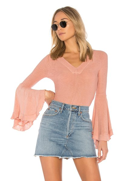 Free People Soo Dramatic Long Sleeve Tee in pink - 95% rayon 5% spandex. Hand wash cold. Knit fabric....