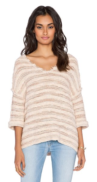 Free People Spells trouble stripe pullover in beige - 92% cotton 8% nylon. Hand wash cold. Frayed trim....