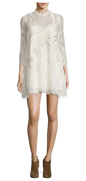 Free People swan lace mini dress in cream - Romantic, embellished mini dress in scalloped lace....