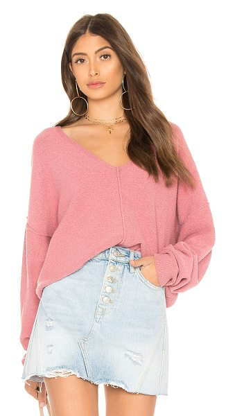 Free People Take Me Places Pullover in pink - Cotton blend. Hand wash cold. Exposed seams. Rib knit...