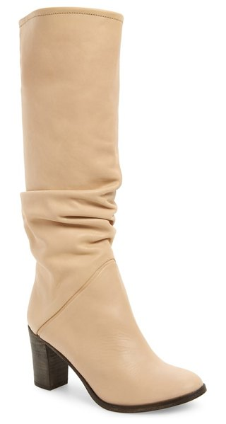 Free People tennison knee high boot in beige - A slouchy silhouette furthers the easygoing appeal of a...