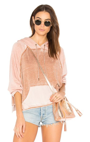 Free People Tri Color Hoodie in pink - Pure relaxation starts with the Tri Color Hoodie from...