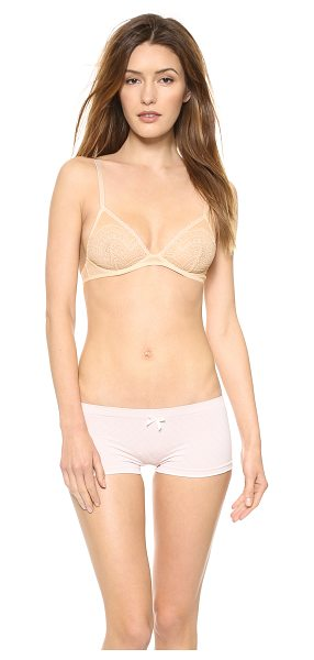 Free People Triangle bra in nude - A soft cup underwire bra in delicate lace. Hook and eye...