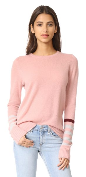 FREECITY strike sleeve cashmere sweater in magical petal tea - Contrast stripes and an intarsia bird detail the long...
