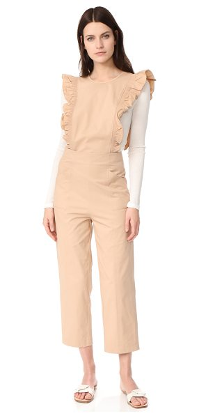 Ganni phillips jumpsuit in cuban sand - NOTE: Runs large. Ruffles trim the sides of this...