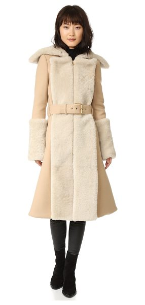 Gareth Pugh double shearling coat in camel - Plush shearling trim gives this Gareth Pugh trench coat...