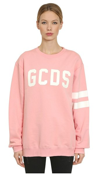 Gcds Glow in the dark logo printed sweatshirt in pink - Glows in the dark. Crewneck. Ribbed collar, cuffs and...