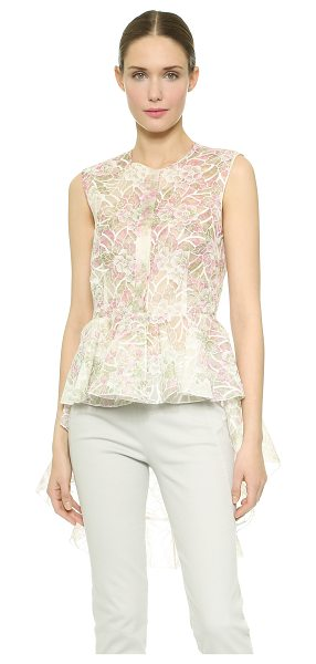 Giambattista Valli Embroidered peplum top in pink - Dainty coloring and floral embroidery infuse this...