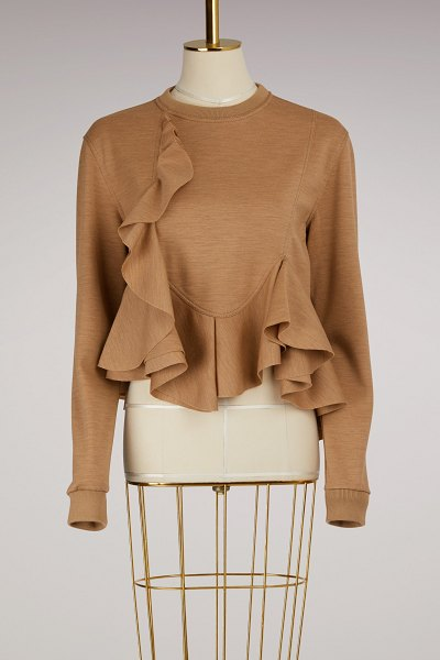 Givenchy Cotton Frill Sweater in beige camel - In a style that screams fantasy and femininity, this...