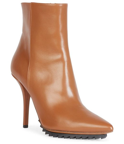 Givenchy iron line leather point-toe ankle boots in caramel - Sharp leather point-toe boot on treaded rubber sole....