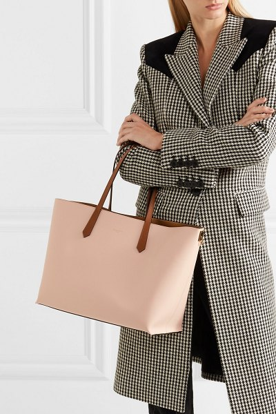 Givenchy printed leather tote in pink - Givenchy's tote is spacious enough to comfortably store...