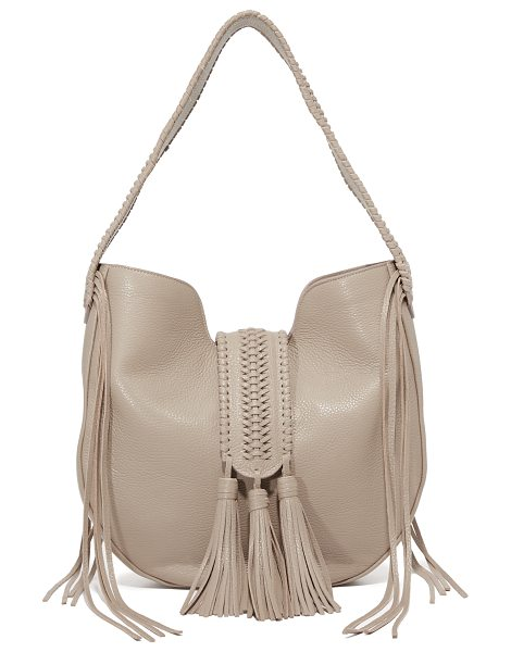 GRACE ATELIER DE LUX Grace Atelier De Lux Bohbo Hobo Bag in latte - A braided magnetic strap with tassels crosses the top of...