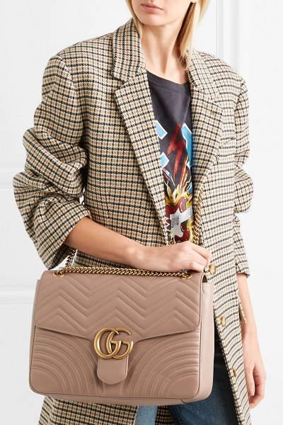 Gucci gg marmont large quilted leather shoulder bag in beige - Gucci's signature 'GG Marmont' bag is designed in an...