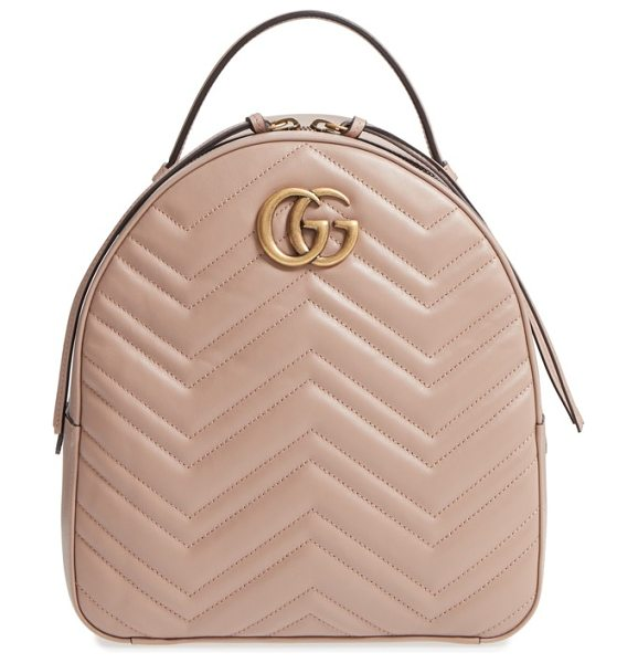 GUCCI gg marmont matelasse quilted leather backpack in porcelain rose - Done in a perfect pink hue, this smooth leather backpack...