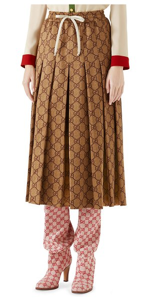 Gucci GG-Print Technical Jersey Pleated Midi Skirt in camel - Technical jersey skirt with allover GG-print. Drawstring...
