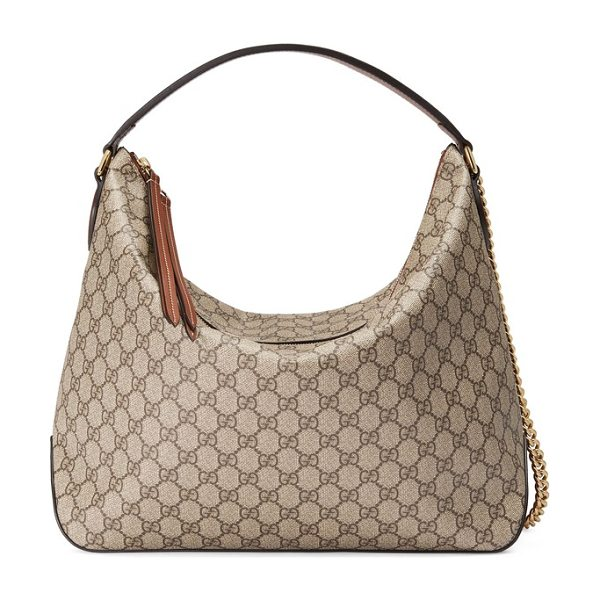 Gucci gg supreme canvas hobo in beige - Rich leather detailing at the stable base and...