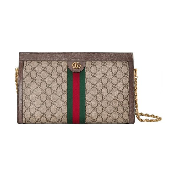 Gucci gg supreme canvas shoulder bag in beige - A web in Gucci's house colors and double-G hardware sets...