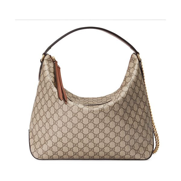 GUCCI Linea A Large GG Supreme Canvas Hobo Bag in light beige/brown - Gucci GG Supreme canvas large hobo bag with leather...