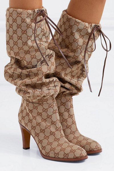 Gucci leather-trimmed coated-canvas knee boots in beige - Beyoncé took to the stage in a version of Gucci's boots...