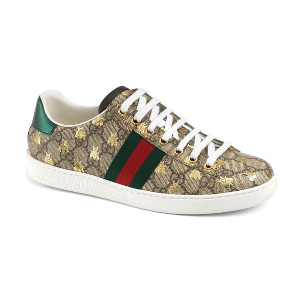 Gucci new ace monogram bee sneaker in beige - Golden bees mingle with a signature double-G pattern...