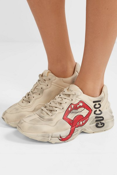 Gucci rhyton logo-print leather sneakers in cream - Gucci updates its best-selling 'Rhyton' sneakers once...