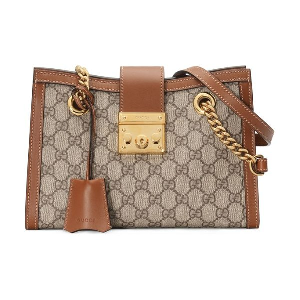 GUCCI small padlock gg supreme shoulder bag - A lock closure drawn from the Gucci archives is paired...