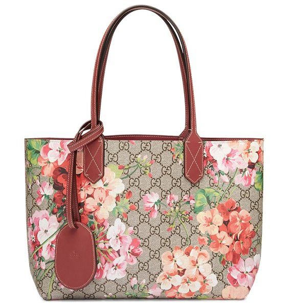 Gucci small turnaround reversible leather tote in pink - Gucci's signature double-G print reverses to smooth...