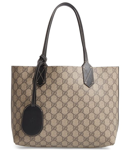 Gucci small turnaround reversible leather tote in beige ebony/blk - Gucci's signature double-G print reverses to smooth...