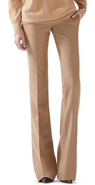 Gucci Wool flare-leg pants in camel - A mid-rise, flared pant that sets the tone for a refined...