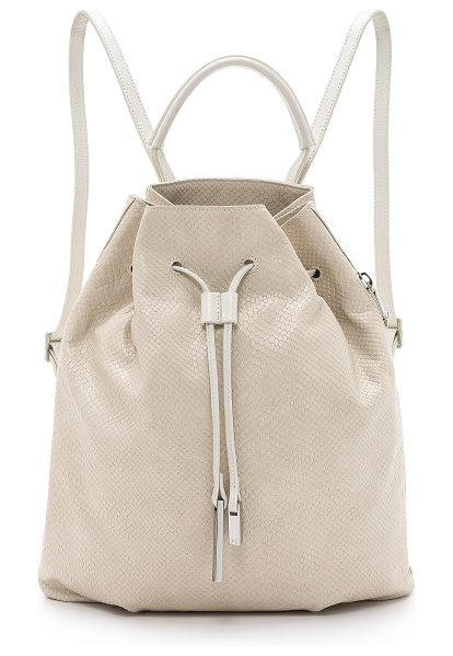 Halston Drawstring backpack in dark bone - Snake embossed leather brings unique texture to this...